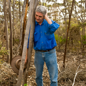 Keith Bradby leaning against a tree